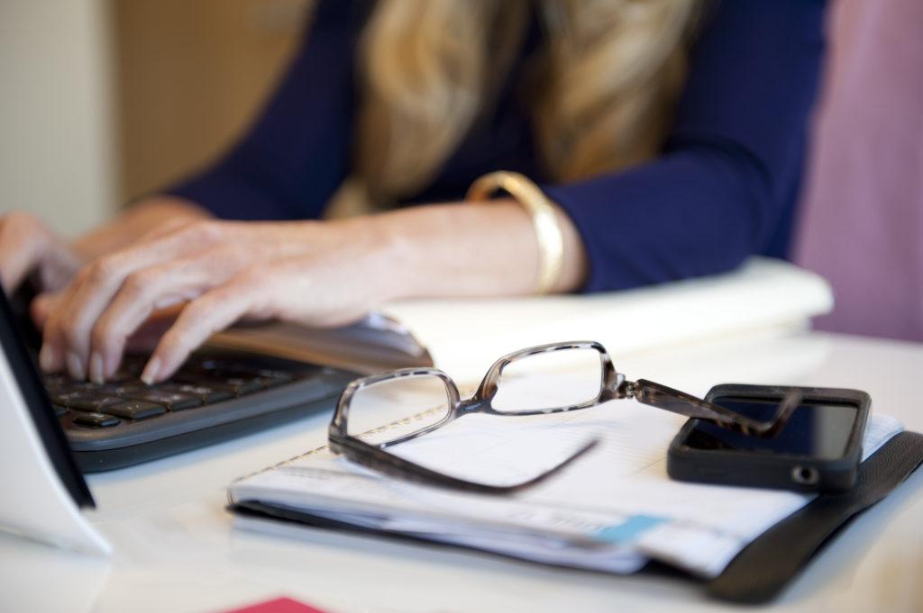 Woman at desk laptop